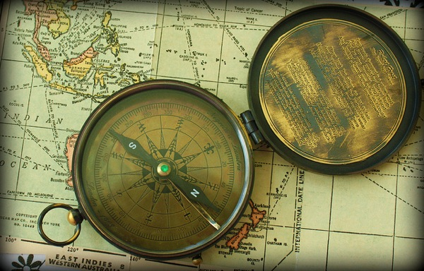 Old compass on a map