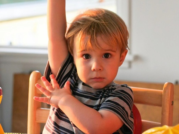 Image of a child raising his hand