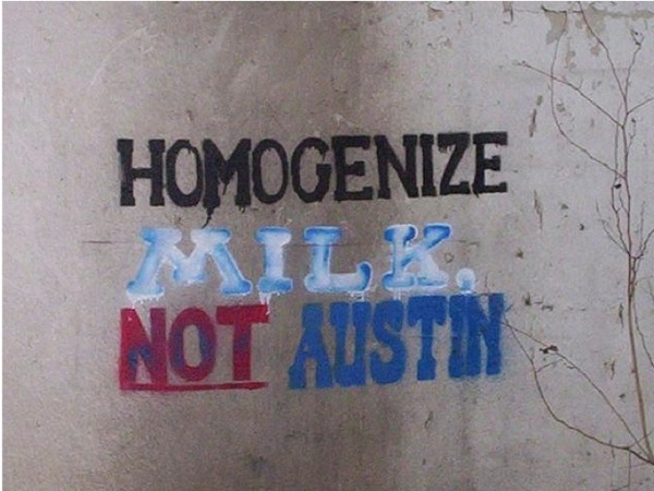 Photo of graffiti that reads: Homogenize Milk, Not Austin