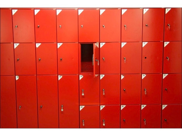 Image of red lockers, with one locker open