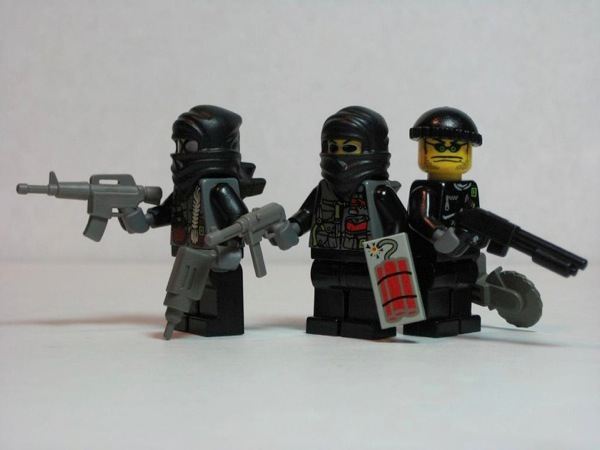 Photograph of three LEGO minifigs dressed as thieves