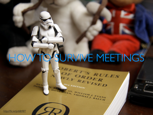 Storm Trooper standing on copy of Robert's Rules of Order. Caption: How to Survive Meetings