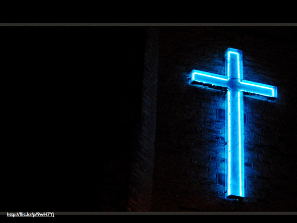 A neon blue cross