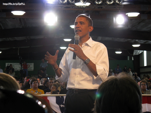 Barack Obama speaking in a town hall setting