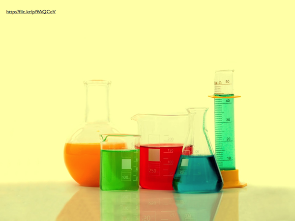 Chemical flasks and beakers, filled with colored liquids