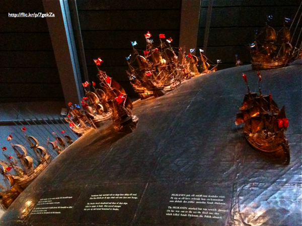 Miniature ship models on a large globe