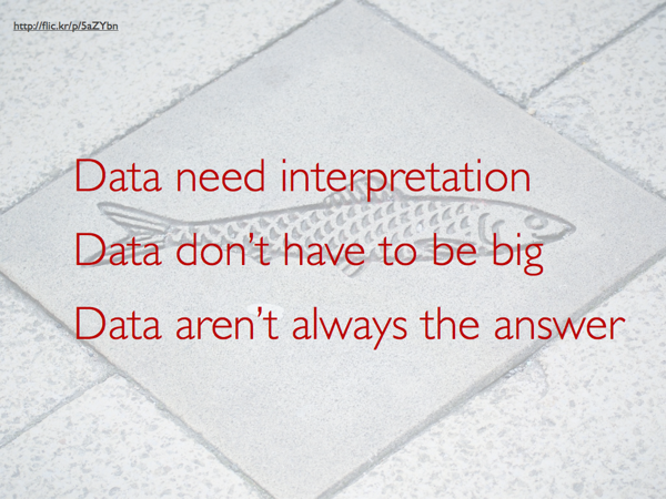 Over a concrete tile with a fish embedded in it, this caption reads, 'Data need interpretation / Data don't have to be big / Data aren't always the answer'