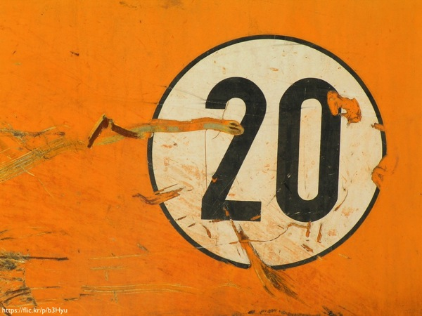 An orange wall with the number 20 painted on it