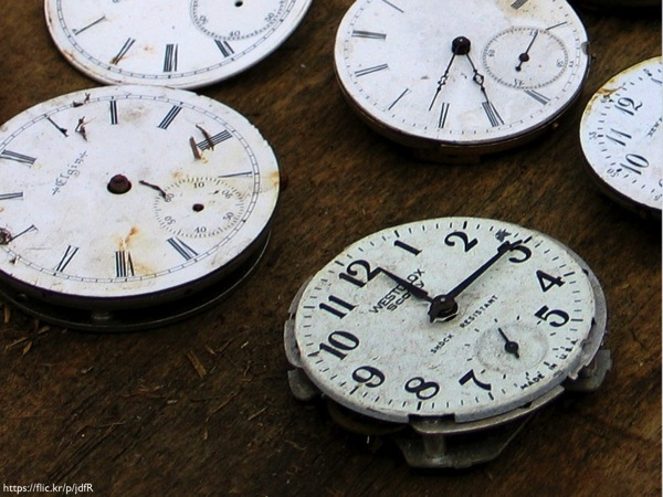 Several broken pocket watches