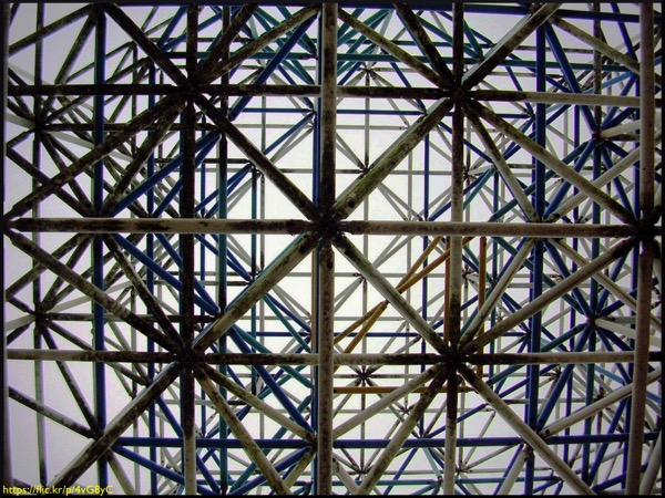 A photograph of metal bars in a power tower shot from below