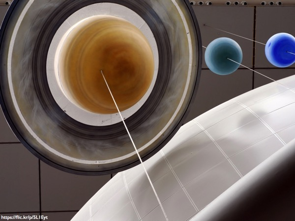 A photograph of model planets hanging from a ceiling