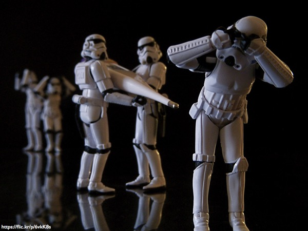 Stormtrooper toys, one about to get its temperature taken