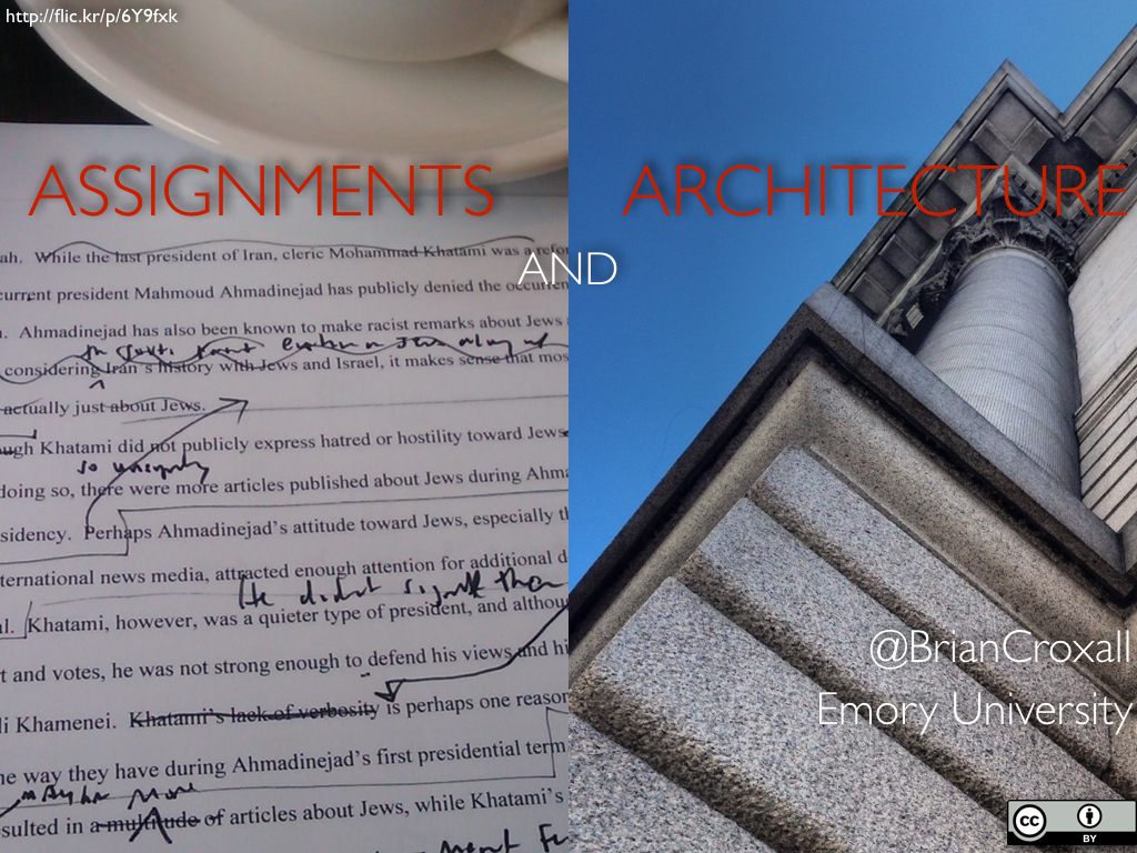 Title slide that reads 'Assignments and Architecture' with a hand-corrected print-out on one side of the screen and a upward-facing shot of a building on the right half. The link on this image is for the assignment as the photograph of the building is one that I took.