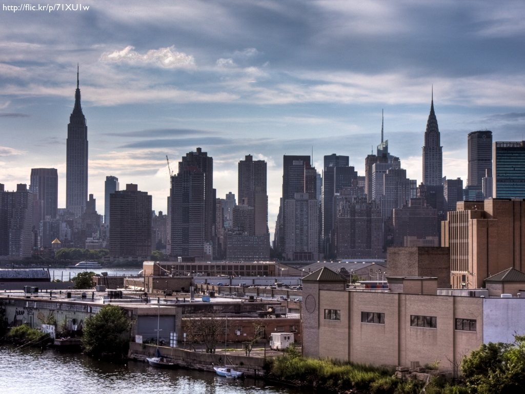 The New York City skyline, with the Empire State Building and Chrysler Building at either end.