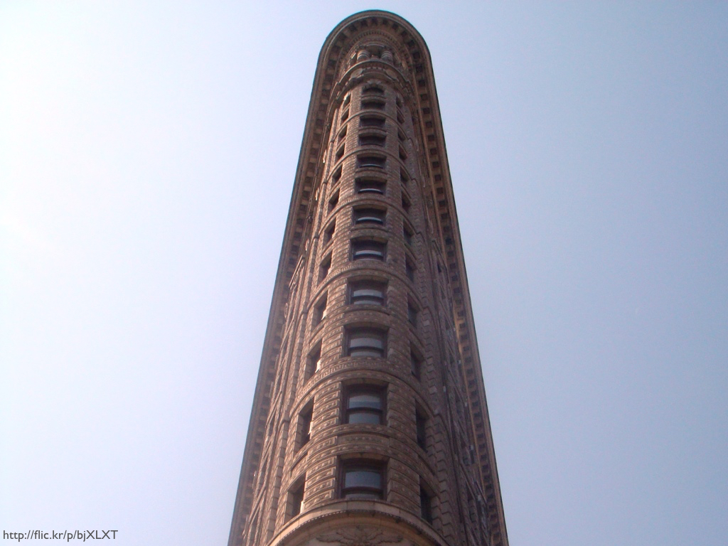 The Flatiron Building, shot from below at its most narrow end.