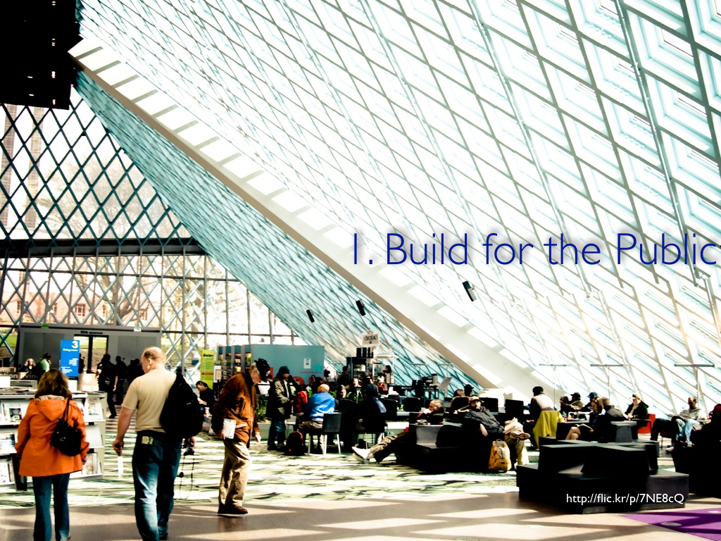 A photo of a glass wall inside the Seattle Public Library's lobby, which is filled with people, with the caption 'I. Build for the Public'