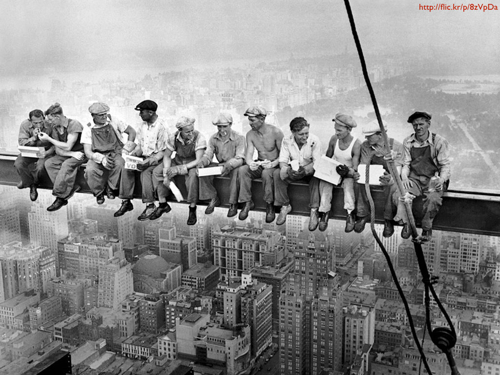 A group of men sitting on a skyscraper girder.