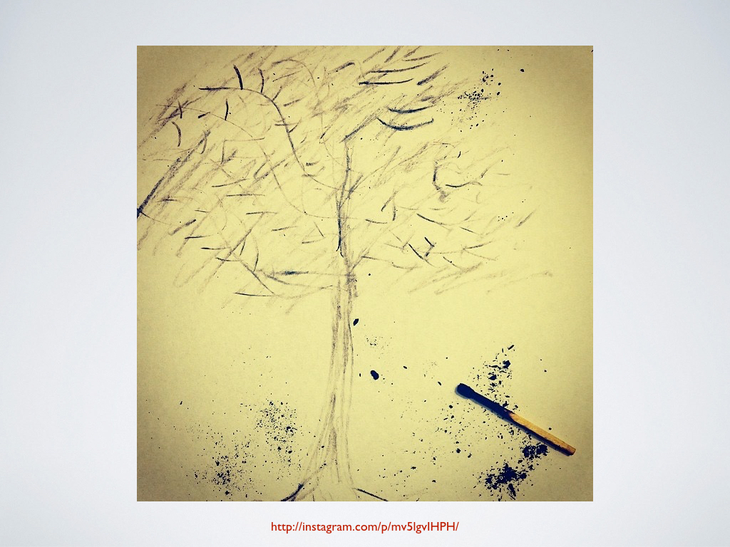 A student-made sketch of an ash tree, made with the ash from a burnt match.