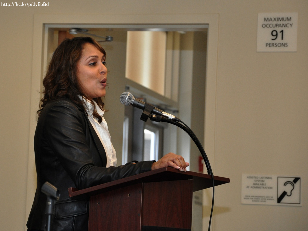 Poet Natasha Trethewey speaking at a podium.
