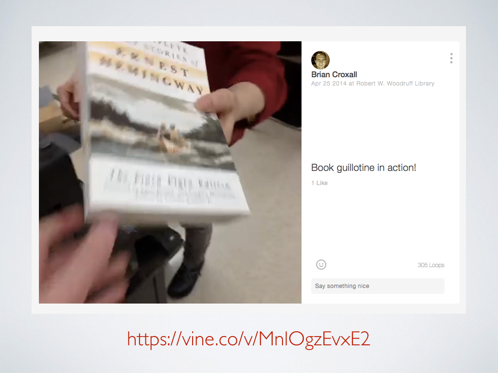 A screenshot of a Vine of Hemingway books being put through a book guillotine to have their bindings removed.