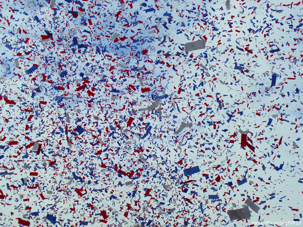 A shot of red, white, and blue confetti from a tickertape parade.