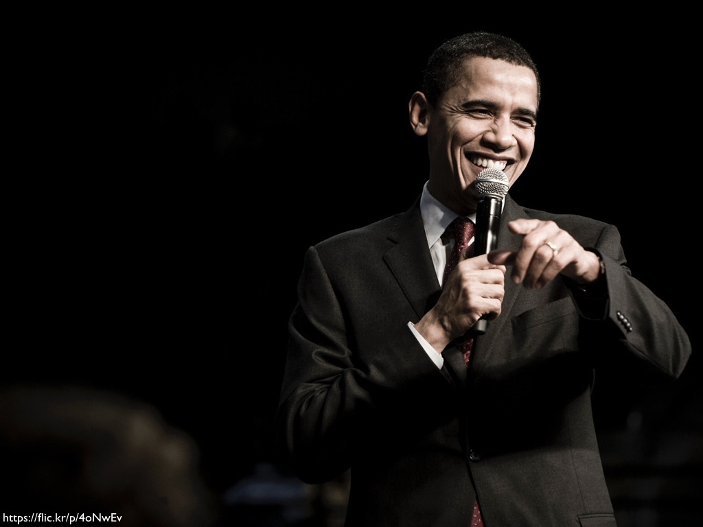 An image of a smiling Barack Obama at a 2008 campaign rally in South Carolina.