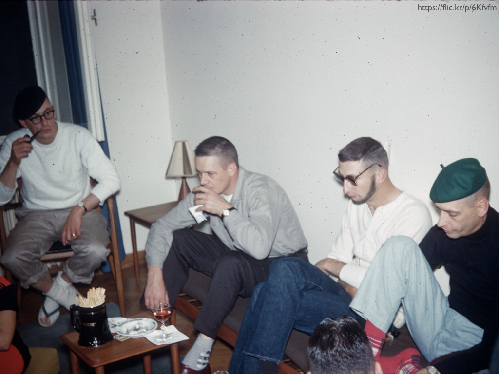 A picture of four male beatniks in the 1960s. Two of the men have berets.