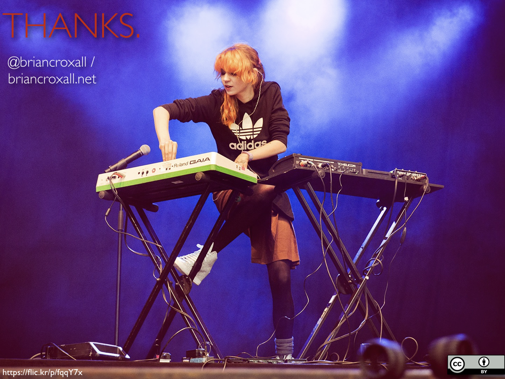 An image of the musician Grimes performing on a stage with two keyboards. The caption reads 'Thanks. | @briancroxall | briancroxall.net'